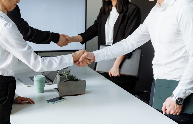 Energy advisor and clients shaking hands